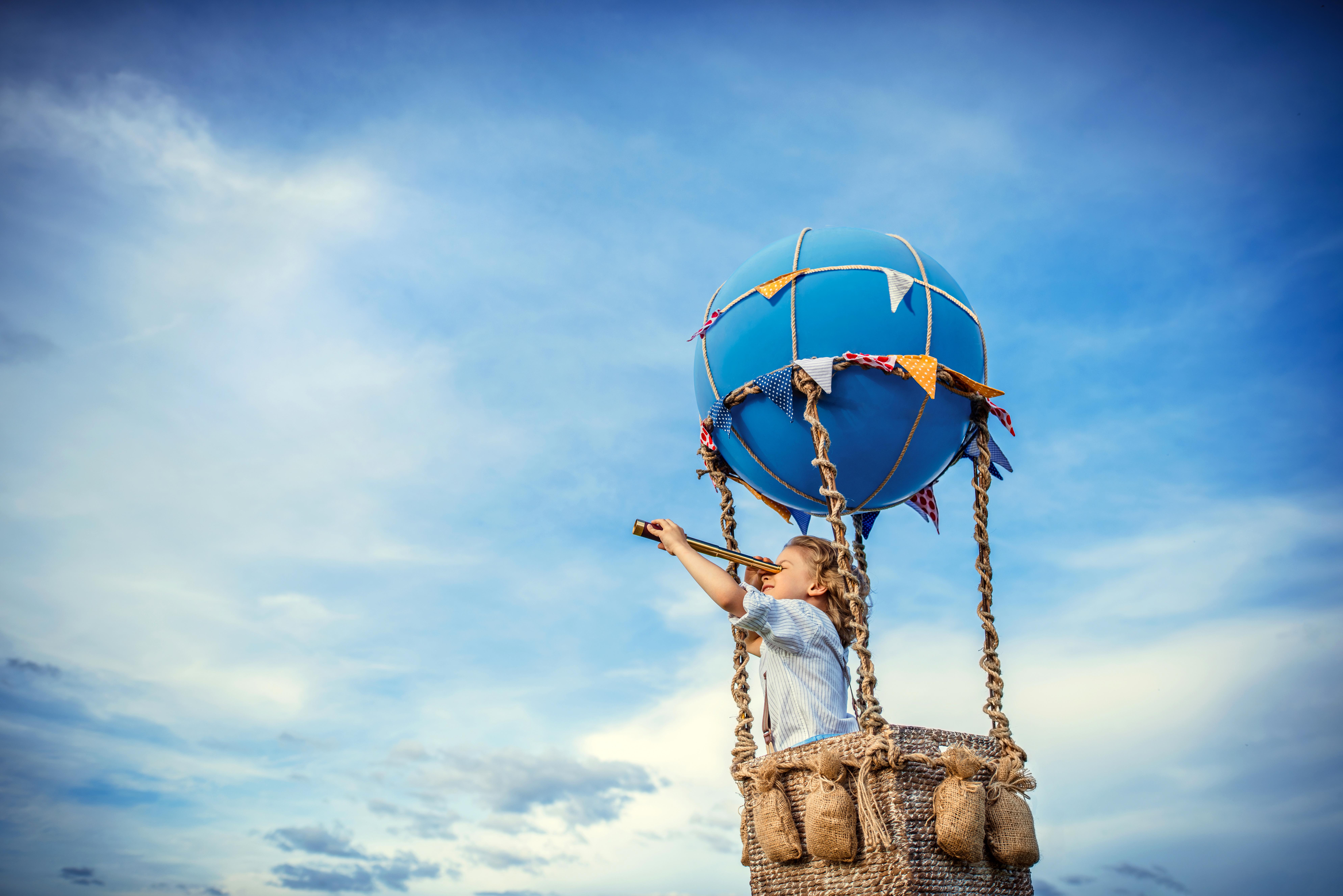 Little boy in a balloon outdoors